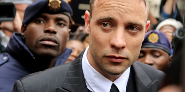 Olympic and Paralympic track star Oscar Pistorius leaves court after appearing for the 2013 killing of his girlfriend Reeva Steenkamp in the North Gauteng High Court in Pretoria, South Africa.