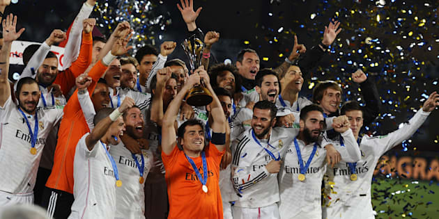 Players pose with the trophy after the FIFA World Cup Final between Real Madrid and San Lorenzo at Marrakech Stadium on December 20, 2014 in Marrakech, Morocco.