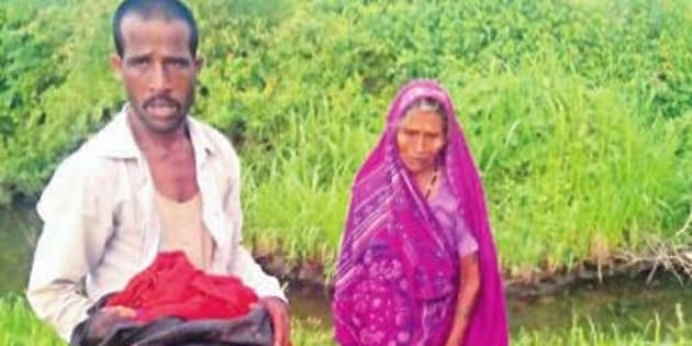 Lodhi with his baby, mother and wife's body.