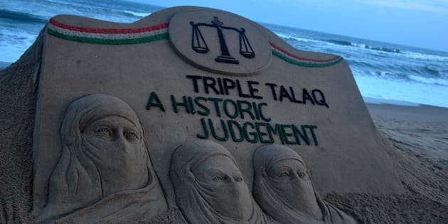 A sand art is seen at the Bay of Bengal,  Sea's eastern coast beach as it created by Indian sand artist Sudarshan Patnaik for public awareness about the Supreme Court Judgement about the muslim community.  On 23 August 2107 in Puri.