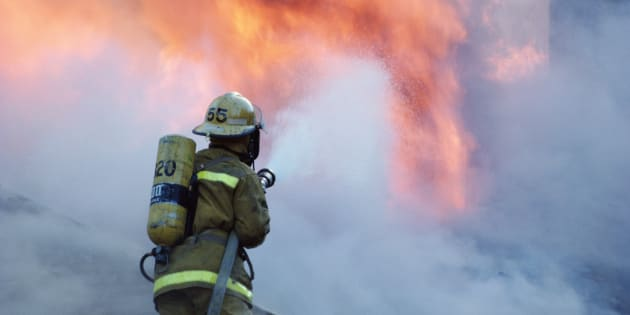 Stock image of a firefighter fighting a blaze.