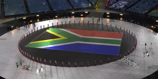 The flag of South Africa is paraded during the opening ceremony of the Pyeongchang 2018 Winter Olympics on February 9, 2018.