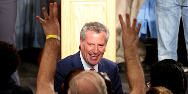 New York Mayor Bill de Blasio is greeted by supporters after his re-election in New York City, U.S. November 7, 2017. REUTERS/Brendan McDermid