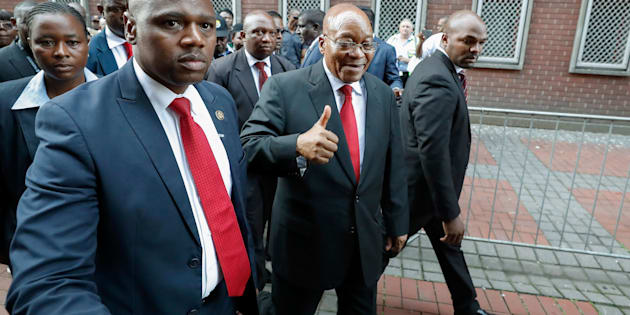 Jacob Zuma gives supporters a thumbs-up as he arrives at the KwaZulu-Natal High Court in Durban on April 6, 2018, to appear for a brief preliminary hearing on corruption charges linked to a multibillion-dollar 1990s arms deal.