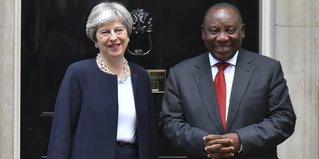 Britain's Prime Minister Theresa May (L) greets South Africa's President Cyril Ramaphosa at 10 Downing Street in central London, prior to bilateral talks on the sidelines of the Commonwealth Heads of Government meeting (CHOGM) on April 17, 2017.