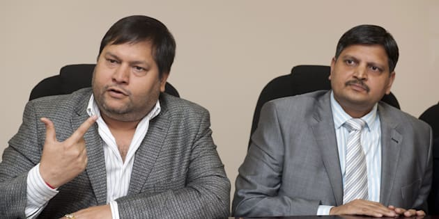 Indian businessmen, Ajay Gupta (R) and younger brother Atul Gupta.