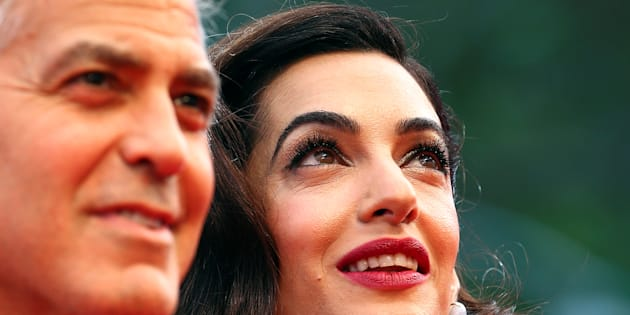 "Actor and director George Clooney and his wife Amal pose during a red carpet event for the movie ""Suburbicon"" at the 74th Venice Film Festival in Venice, Italy September 2, 2017. REUTERS/Alessandro Bianchi"