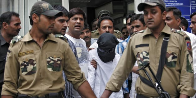 Sayeed Zabiuddin Ansari, also known as Abu Jundal, with his face covered, leaves from a hospital in New Delhi June 29, 2012.