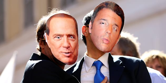 5-Star Movement supporters wear masks depicting former Italian Prime Ministers Silvio Berlusconi (L) and Matteo Renzi during a protest in front of Montecitorio government palace in Rome, Italy, October 11, 2017. REUTERS/Alessandro Bianchi