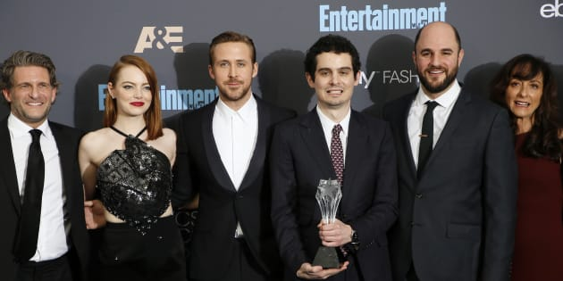 """(L-R) Producer Gary Gilbert, actors Emma Stone and Ryan Gosling, director Damien Chazelle, producer Jordan Horowitz and costume designer Mary Zophres pose backstage with their award for Best Picture for 'La La Land"""" during the 22nd Annual Critics' Choice Awards in Santa Monica, California."""