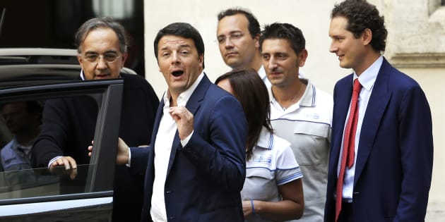 """Italian Prime Minister Matteo Renzi (2nd L) gestures during a meeting  with Fiat Chairman John Elkann (R) and Fiat Chief Executive Sergio Marchionne (L) to mark the presentation of new """"Jeep Renegade"""" car at Chigi palace, in Rome July 25, 2014.  REUTERS/ Max Rossi ( ITALY - Tags: POLITICS TRANSPORT BUSINESS)"""