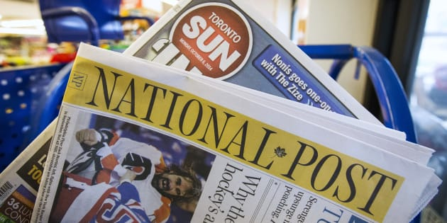 Toronto Sun and National Post newspapers are posed in front of a news stand in Toronto, October 6, 2014.