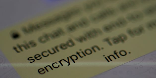 An encryption message is seen on the  WhatsApp application on an iPhone in Manchester, Britain March 27, 2017.