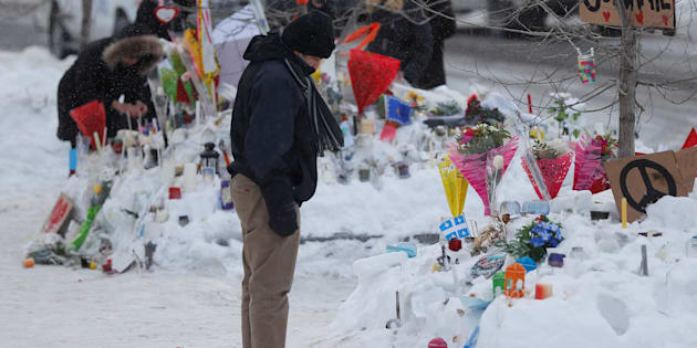 A man looks at the memorial near the site of a fatal shooting at the Quebec Islamic Cultural Centre in Quebec City, Jan. 31, 2017.