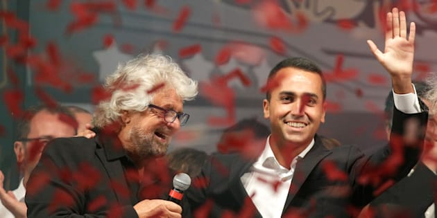 5-Star movement founder Beppe Grillo (L) stands next to Luigi Di Maio during a gathering in Rimini, Italy, September 23, 2017. REUTERS/Max Rossi