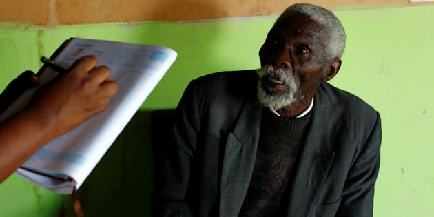 Former gold miner Senzele Silewise, 81, diagnosed with silicosis, talks to paralegals in Bizana in South Africa's impoverished Eastern Cape province March 7, 2012. REUTERS/Mike Hutchings/File Photo