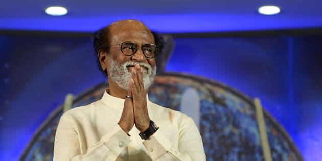 Rajinikanth gestures as he arrives to meets his fans during a interaction session with fans in Chennai on December 29, 2017.