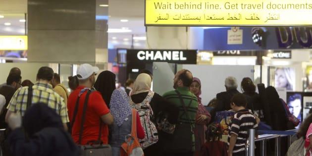 Des passagers font la queue en 2013 à l'aéroport du Caire (photo d'illustration). Le même aéroport où une famille irakienne a été refoulée à la suite du décret pris par Donald Trump.