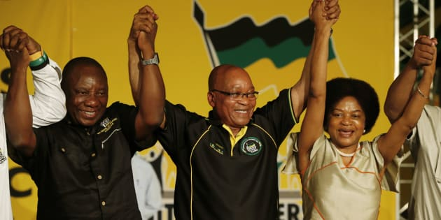 South Africa's President Jacob Zuma (2nd R) celebrates his re-election as party President alongside newly-elected party Deputy President Cyril Ramaphosa (2nd L) and re-elected Chairperson Baleka Mbete (R) at the National Conference of the ruling African National Congress (ANC) in Bloemfontein December 18, 2012.