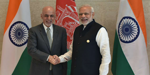 Indian Prime Minister Narendra Modi (R) shakes hands with Afghan President Ashraf Ghani (L) during the 6th Heart of Asia Ministerial Conference in Amritsar on December 4, 2016.