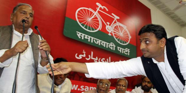 File photo of Akhilesh Yadav (R), the chief minister-designate of the northern Indian state of Uttar Pradesh and party president of the Samajwadi Party President Mulayam Singh Yadav.