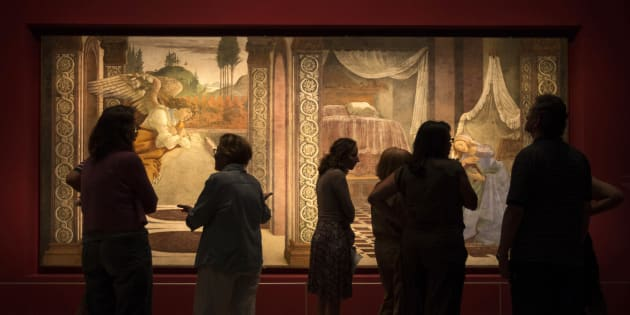 "Museum workers stand in front of a fresco by Italian renaissance painter Sandro Botticelli titled, ""The Annunciation of San Martino alla Scala"" at the Israel Museum in Jerusalem September 17, 2013. The fresco, on loan from the Uffizi Gallery in Florence, is the first Botticelli ever to be exhibited at the Israel Museum. REUTERS/Baz Ratner (JERUSALEM - Tags: SOCIETY ENTERTAINMENT)"