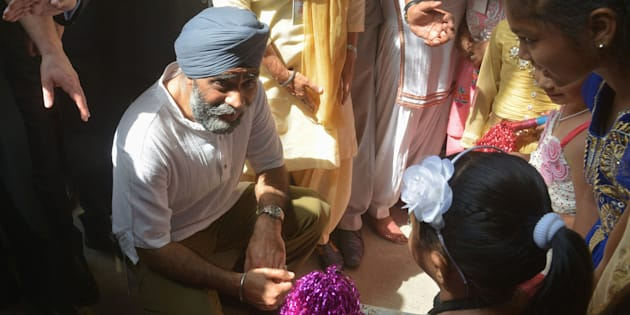 Canada's Defence Minister Harjit Singh Sajjan (C) talks to children during his visit to the All India Pingalwara Charitable Society at Manawala village on the outskirts of Amritsar on 20 April 2017.