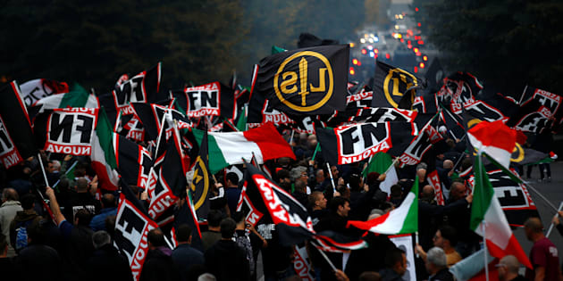 Supporters of Italy's far-right Forza Nuova party wave flags during a demonstration in Rome, Italy November 4, 2017. REUTERS/Stefano Rellandini