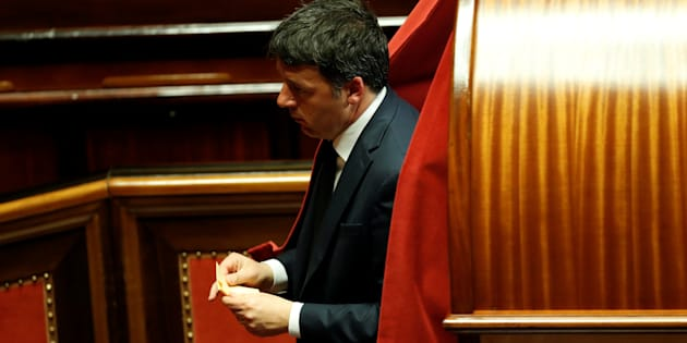 Former Prime Minister and senator Matteo Renzi casts his vote at the Senate during the second session since the March 4 national election in Rome, Italy March 23, 2018. REUTERS/Remo Casilli