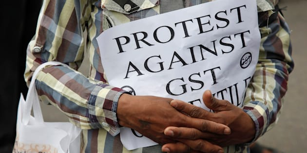 Amit Mitra slams Govt over GST launch