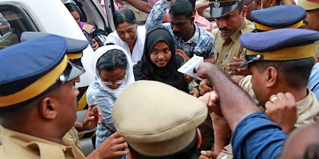 Akhila, 24, who converted to Islam in 2016 and took a new name, Hadiya, arrives at the airport in Kochi, India November 25, 2017. REUTERS/Sivaram V