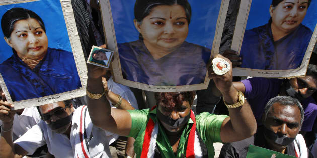 Supporters of J. Jayalalithaa, chief minister of Tamil Nadu and chief of the AIADMK party. REUTERS/Babu