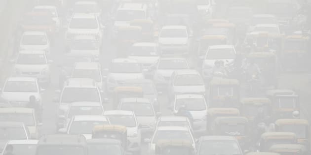 Vehicles drive through heavy smog in Delhi, India, November 8, 2017.