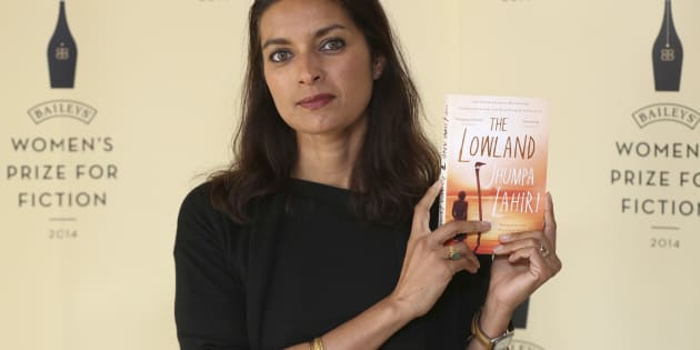 "Author Jhumpa Lahiri poses with her novel ""The Lowland"", ahead of the 2014 Bailey's Women's Prize for Fiction in London June 4, 2014."
