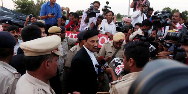 S. K. Garg Narwana, lawyer of Gurmeet Ram Rahim Singh, a self-styled godman, speaks with the media after the court hearing.