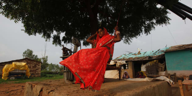 Child bride Krishna, 12, plays on an improvised swing outside her house in a village near Baran, located in the northwestern state of Rajasthan, July 30 , 2011.