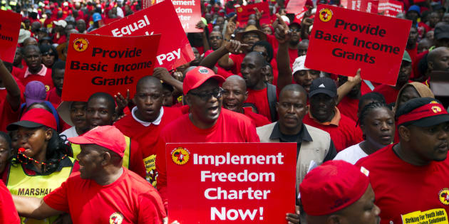 Suspended general secretary of the Congress of South African Trade Unions (COSATU) Zwelinzima Vavi (C) protests with members of the National Union of Metal Workers of South Africa (NUMSA) as they march through Durban, March 19, 2014. South Africa's largest union called for a one day strike on Wednesday to highlight youth unemployment in the country, where one in four people are jobless, the union said. The 340,000-member NUMSA draws its members from car manufacturing, the metal industry, transport and general workers. REUTERS/Rogan Ward (SOUTH AFRICA - Tags: BUSINESS EMPLOYMENT POLITICS CIVIL UNREST INDUSTRIAL)
