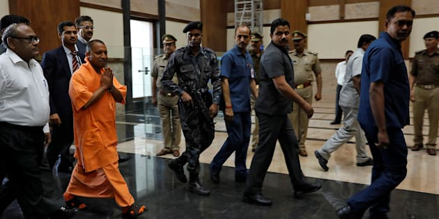Yogi Adityanath, newly appointed Chief Minister of India's most populous state of Uttar Pradesh, arrives to attend a meeting with government officials at Lok Bhavan in Lucknow.