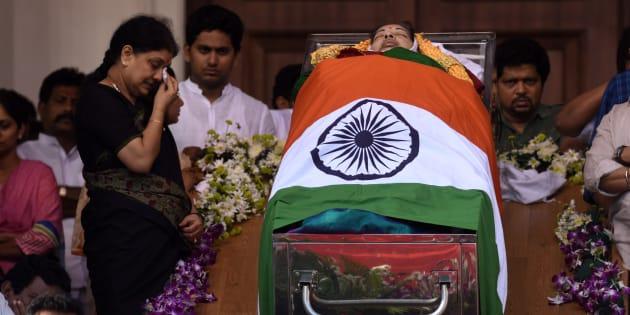 Sasikala is seen next to the coffin of late Tamil Nadu Chief Minister Jayalalithaa Jayaram at Rajaji hall in Chennai.