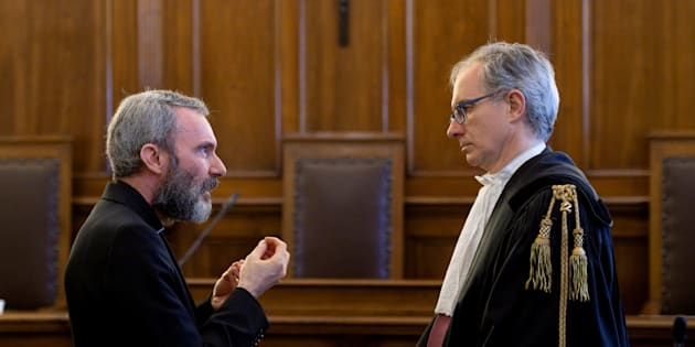 Father Carlo Alberto Capella, a Catholic priest sentenced to five years in jail for possessing child pornography, talks with his lawyer during a trial at the Vatican June 23, 2018. Vatican Media/Handout via REUTERS  ATTENTION EDITORS - THIS IMAGE WAS PROVIDED BY A THIRD PARTY     TPX IMAGES OF THE DAY