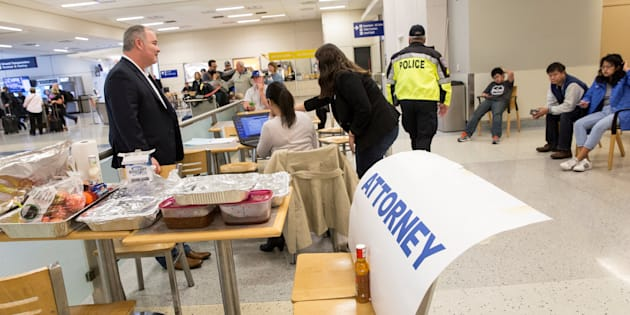 Attorneys volunteer their services at Dallas/Fort Worth International Airport after a federal judge in Washington state issued a nationwide stop of the travel ban imposed by U.S. President Donald Trump's executive order in Dallas, Texas.