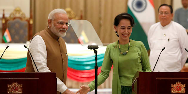 India's Prime Minister Narendra Modi and Myanmar's State Counselor Aung San Suu Kyi talk to reporters during their joint press conference.