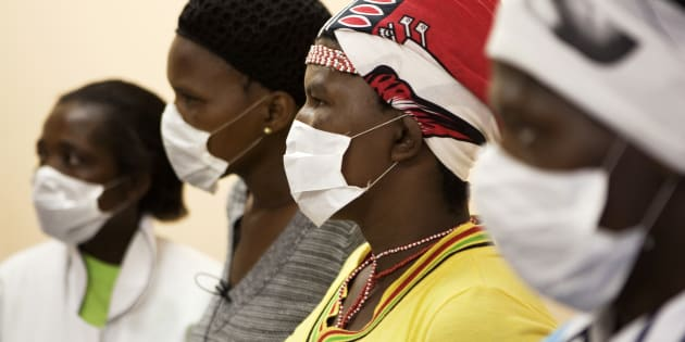 Patients with HIV and tuberculosis (TB) wear masks while awaiting consultation at a clinic in Cape Town's Khayelitsha township, February 23, 2010.