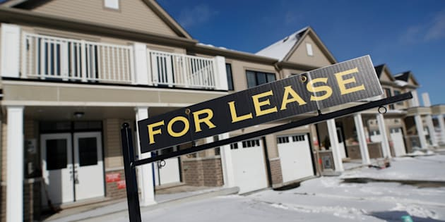 "A ""for lease"" sign stands in front of a row of houses in a newly build subdivision in East Gwillimbury, Ont., north of Toronto, Jan. 30, 2018."