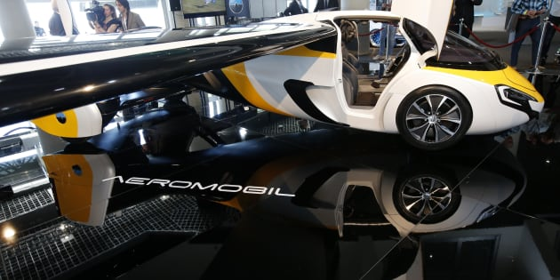 People look at the AeroMobil flying car during its unveiling at the Top Marques Monaco supercar show in Monaco April 20, 2017.
