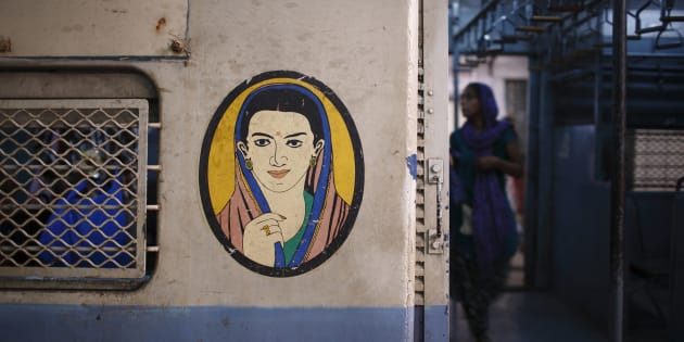 A portrait of a woman is seen near the entrance of the female compartment of a suburban train at Chhatrapati Shivaji Terminus Railway Station in Mumbai November 2, 2012.