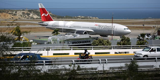 A plane from Russian company Nordwind is seen at Simon Bolivar Airport in Caracas, Venezuela, January 29, 2019. REUTERS/