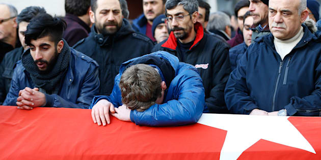 Relatives react at the funeral of Ayhan Arik, a victim of an attack by a gunman at Reina nightclub, in Istanbul, Turkey, January 1, 2017.