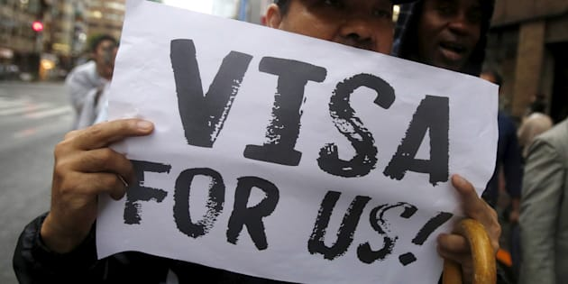 A protester holding a placard shouts slogans at a rally to call for visa grants for asylum seekers in Japan, in central Tokyo, September 9, 2015.