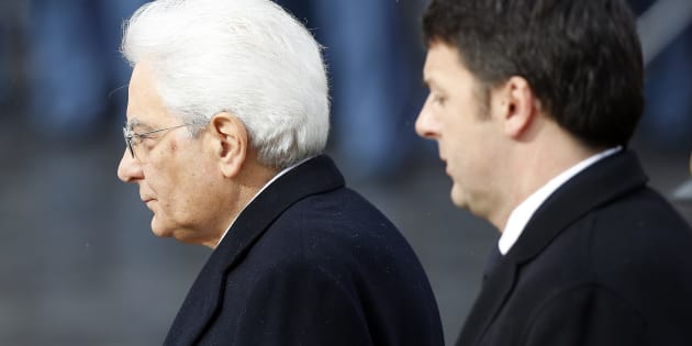 Italy's new President Sergio Mattarella (L) and Prime Minister Matteo Renzi arrive at the Unknown Soldier's monument in central Rome, February 3, 2015. REUTERS/Remo Casilli  (ITALY  - Tags: POLITICS)